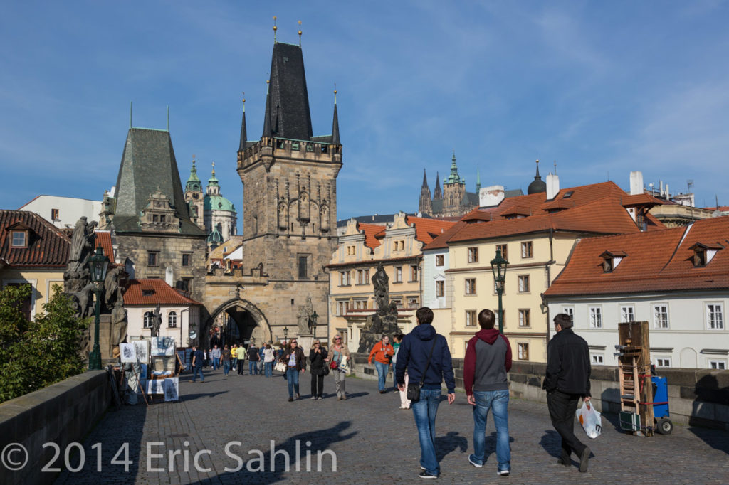 Both sides of the  Bridge have towers. Prague Castle is in the background