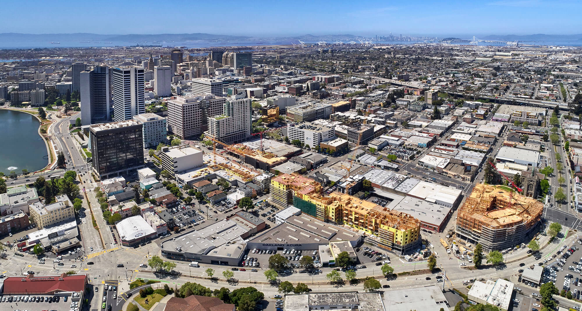Areal panorama of downtown Oakland with San Francisco in the Background